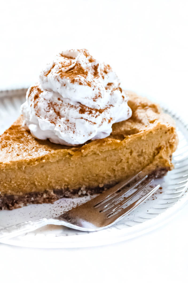 Close-up image of a slice of Gluten-Free Vegan No-Bake Pumpkin Pie with a silver fork next to it