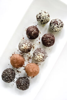 Overhead view of Gluten-Free Vegan Healthy No-Bake Crunchy Protein Energy Balls on a white platter on a white surface