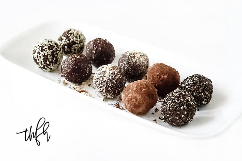 Horizontal image of Gluten-Free Vegan Healthy No-Bake Crunchy Protein Energy Balls on a white platter on a white surface