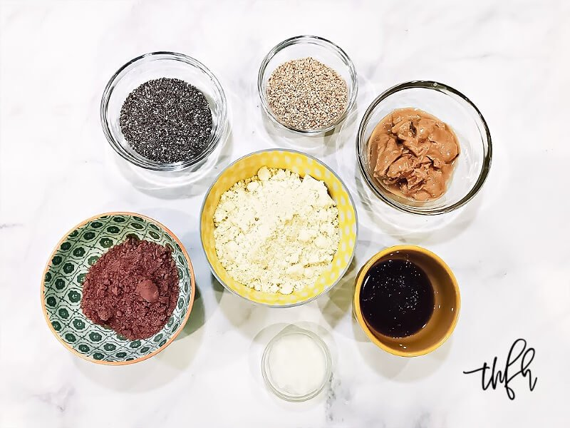 Overhead view of the ingredients for Gluten-Free Vegan Healthy No-Bake Crunchy Protein Energy Balls in individual bowls