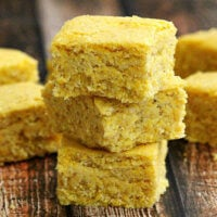Stack of The BEST Vegan Cornbread squares on a wooden surface