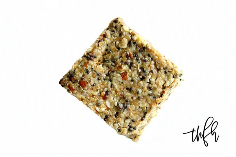 A single Gluten-Free Vegan No-Bake Hemp and Chia Seed Bar on a solid white background