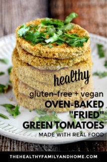 "Vertical image of a stack of six of The BEST Gluten-Free Vegan Oven-Baked ""Fried"" Green Tomatoes on a white plate on a wooden surface with text overlay"