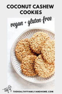 Decorative grey plate filled with Gluten-Free Vegan Flourless Coconut Cashew Cookies with a solid grey border and text overlay