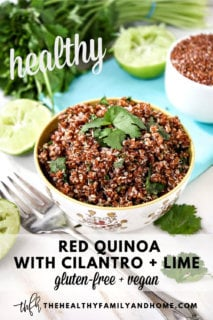 Vertical image of a small decorative bowl filled with Red Quinoa with Cilantro and Lime with a fork next to the bowl and squeezed limes to the side with text overlay