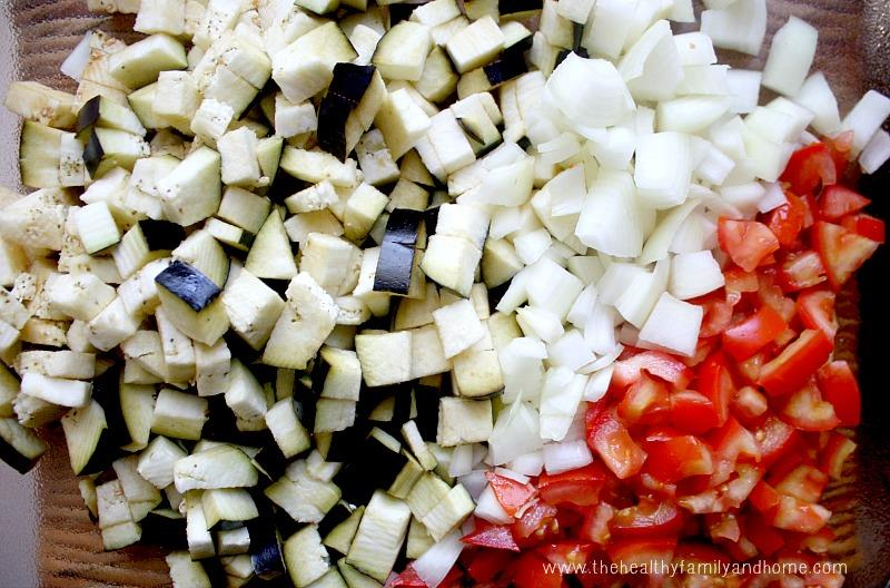 Overhead view of the ingredients used to make Vegan Eggplant Onion and Tomato Stew