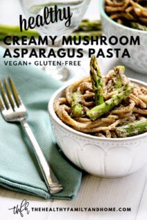 The BEST Gluten-Free Vegan Creamy Mushroom Asparagus Pasta in a white bowl on a white wooden surface with text overlay