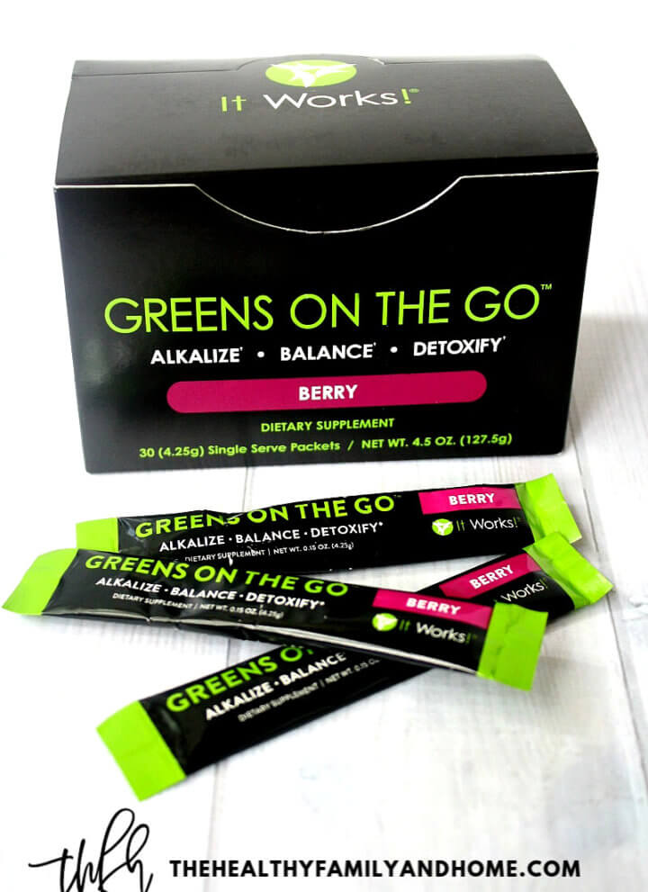 """A box of """"Greens On The Go"""" Berry by It Works! on a white wooden surface"""