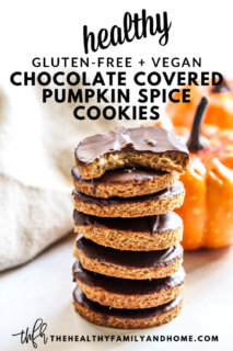 A stack of pumpkin cut-out cookies with chocolate frosting in front of two small pumpkins with text overlay