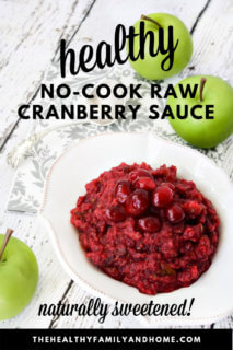 Overhead view of a white bowl filled with no-cook cranberry sauce with apple to the side of the bowl and text overlay