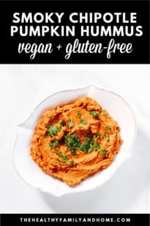 Close-up overhead image of a white bowl filled with Gluten-Free Vegan Smoky Chipotle Pumpkin Hummus on a solid white background with text overlay