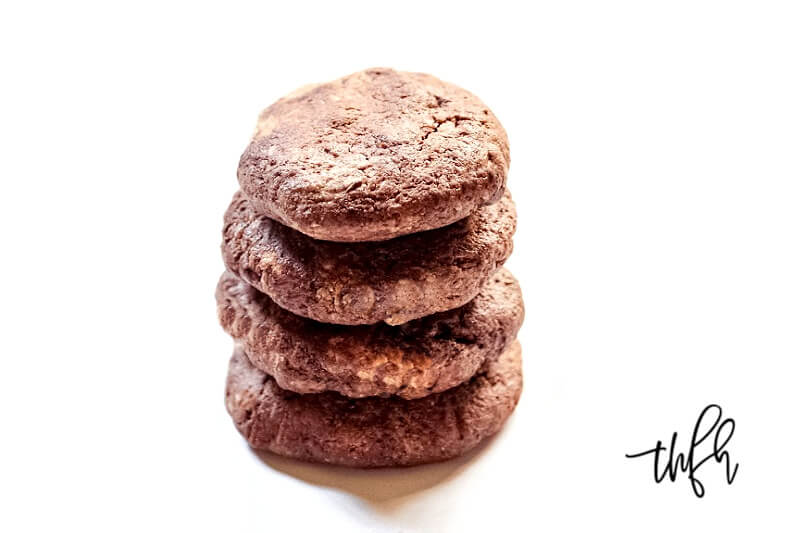 Stack of four Gluten-Free Vegan Flourless Chocolate Fudge Mint Cookies on a white background
