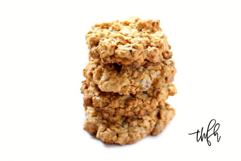 Stack of four Gluten-Free Vegan Peanut Butter Chocolate Chip Oatmeal Cookies on a white background