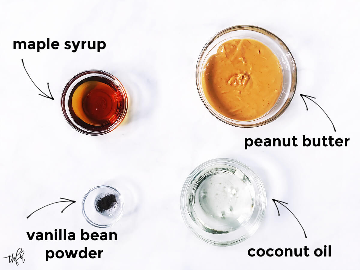 Overhead image of the ingredients needed to make peanut butter fudge in glass bowls on a solid white surface with text overlay