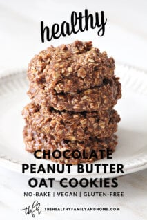 Vertical image of The ORIGINAL Healthy No-Bake Chocolate Peanut Butter Oat Cookies stacked on a white plate on a white marble surface with text overlay