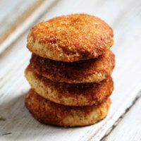 Stack of 4 Gluten-Free Vegan Flourless Snickerdoodle Cookies on a white wooden surface