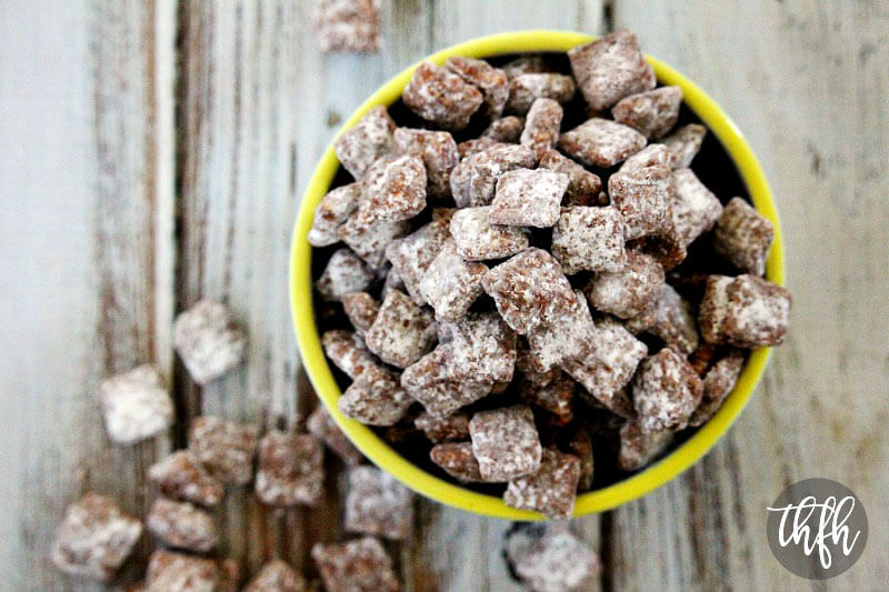"""Overhead view of The BEST Puppy Chow (aka """"Muddy Buddies"""") in a yellow rimmed bowl on a wooden surface"""