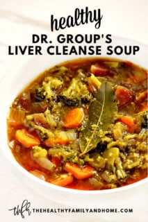 Vertical image of a white bowl filled with Dr. Group's Liver Cleanse Detox Soup on a white marble surface with text overlay