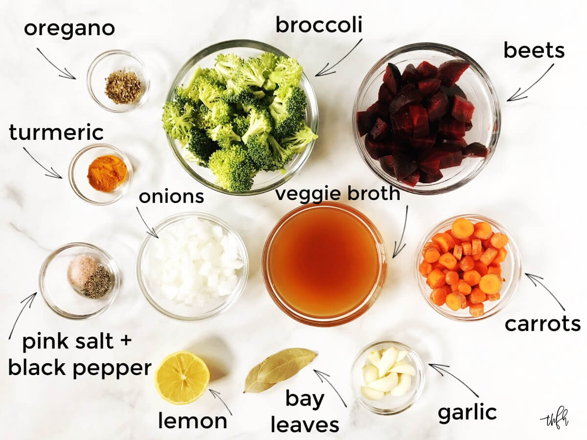 Overhead image of all the ingredients needed to make a liver cleanse soup labeled with text