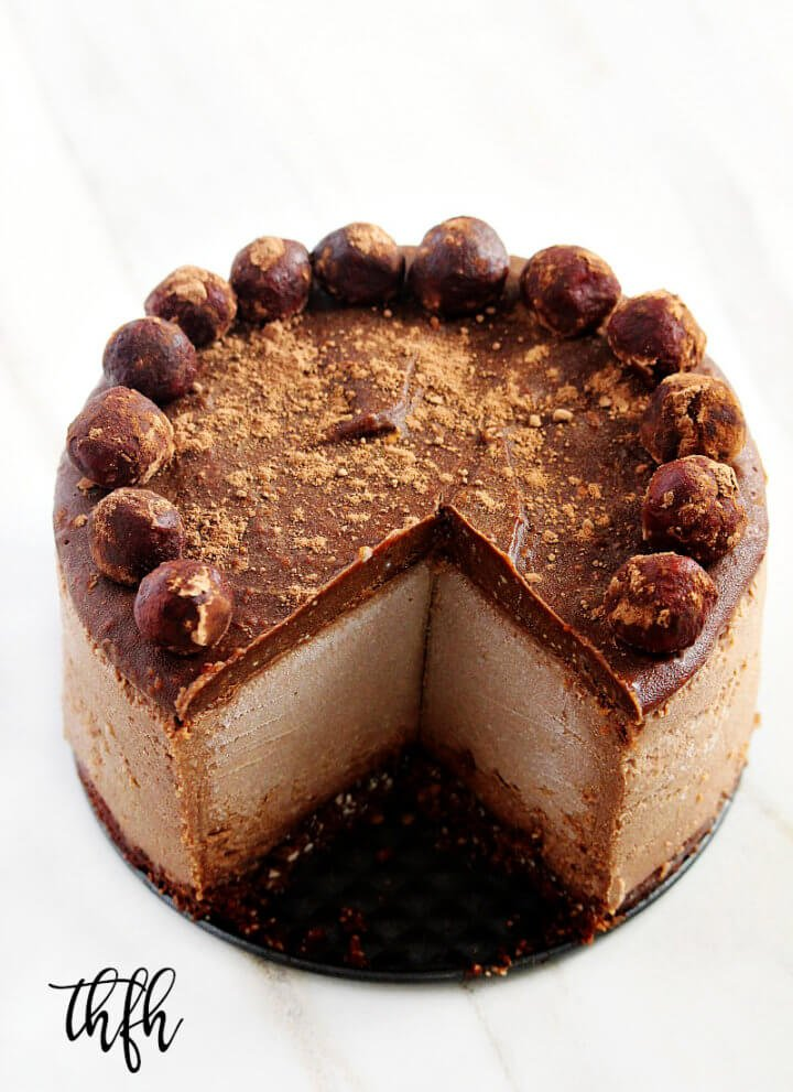 This Gluten-Free Vegan No-Bake Chocolate Peanut Butter Cheesecake recipe is a healthy yet decadent dessert! Raw, Vegan, Gluten-Free, Dairy-Free, Egg-Free, Soy-Free, No-Bake and No Refined Sugar! | The Healthy Family and Home #rawfoods #vegan #dairyfree #glutenfree #grainfree #dessert #cheesecake #vegancheesecake #chocolate #peanutbutter #healthyrecipe #healthydessert #nobake #nobakedessert #recipe #healthyrecipe #healthy