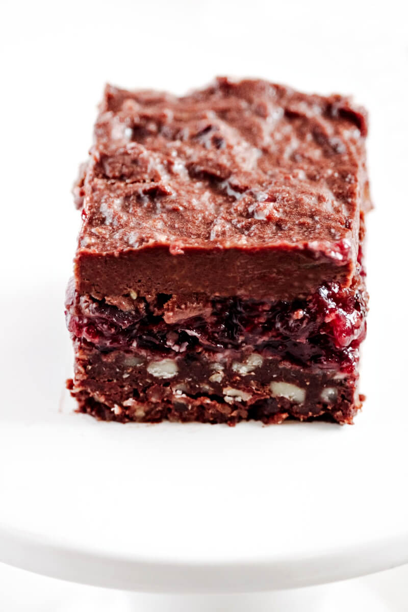 Close-up image of a single Gluten-Free Vegan No-Bake Black Forest Bar on a solid white background