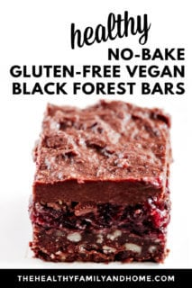 A single Gluten-Free Vegan No-Bake Black Forest Bar on a white cake platter on a white background with text overlay