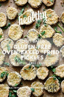 """Overhead view of a baking sheet full of The BEST Gluten-Free Vegan Oven-Baked """"Fried"""" Pickles on top of parchment paper"""