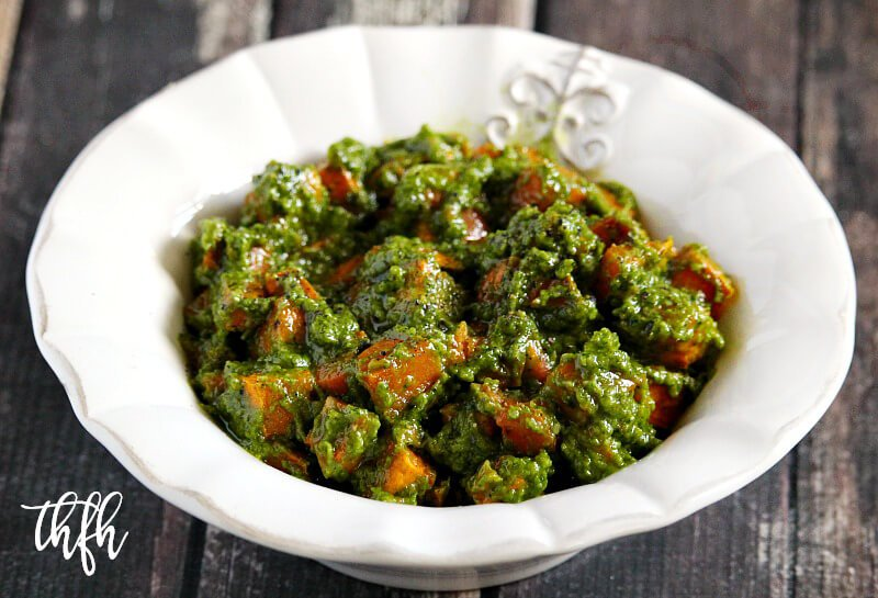 Lectin-Free and Gluten-Free Vegan Cilantro Pesto Sweet Potato Salad in a white bowl on a wooden surface