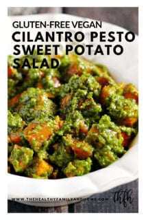 Vertical view of Lectin-Free and Gluten-Free Vegan Cilantro Pesto Sweet Potato Salad in a white bowl on a wooden surface with text overlay