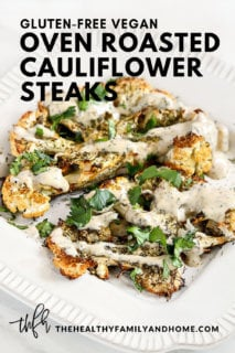 """Vertical image of Gluten-Free Vegan Roasted Cauliflower """"Steaks"""" with Lemon Dill Tahini Dressing on a white plate on a white marble surface with text overlay"""