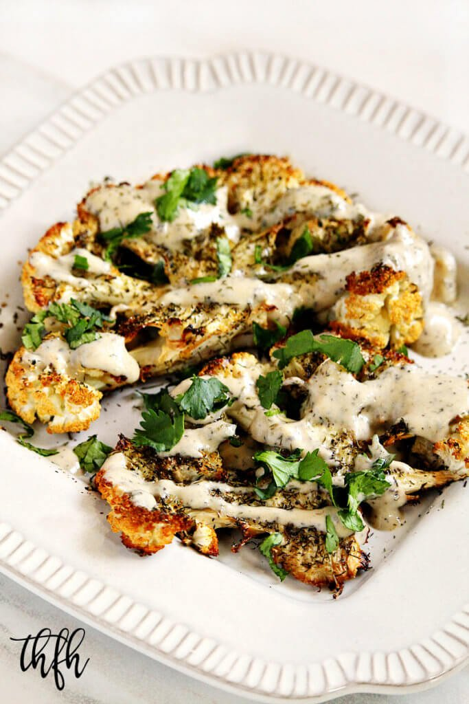 "Gluten-Free Vegan Roasted Cauliflower ""Steaks"" with Lemon Dill Tahini Dressing"