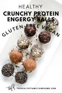 Vertical image of Gluten-Free Vegan Healthy No-Bake Crunchy Protein Energy Balls on a white platter on a white surface