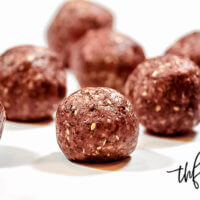 Horizontal view of 9 Gluten-Free Vegan Healthy Triple Seed Energy Balls on a white surface