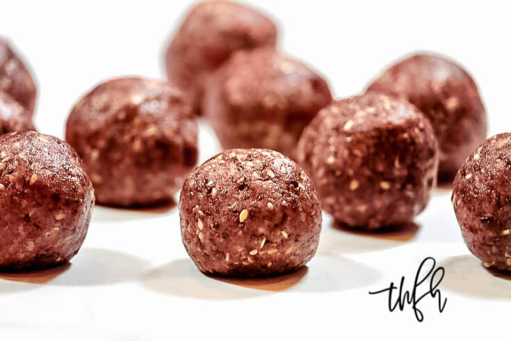 This easy plant-based Gluten-Free Vegan Healthy Triple Seed Energy Balls recipe is made with only 9 clean, real food ingredients that are nutrient-dense and they're ready to enjoy in less than 10 minutes using just a food processor. This is a no-bake kid-friendly energy ball recipe that everyone will love! { The Healthy Family and Home } #energyballs #vegan #medicalmedium #healthy