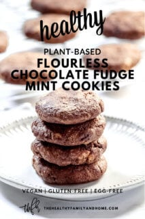 Stack of four Gluten-Free Vegan Flourless Chocolate Fudge Mint Cookies on a white plate with more cookies on a wire rack in the background with text overlay
