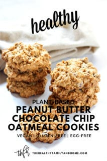 Stacks of Gluten-Free Vegan Peanut Butter Chocolate Chip Oatmeal Cookies on a white surface with text overlay
