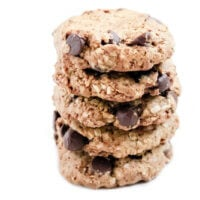 Horizontal image of four of The BEST Gluten-Free Vegan Chocolate Chip Oatmeal Cookies on a white background
