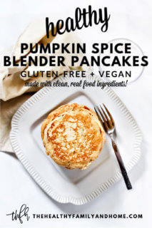Overhead image of a decorative grey plate with a stack of Gluten-Free Vegan Pumpkin Spice Blender Pancakes with a glass of milk and cream cloth napkin on the side and text overlay