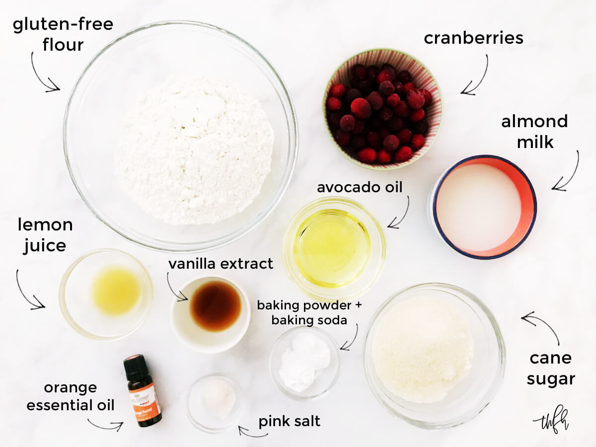 Overhead image of ingredients needed to make cranberry orange muffins on a solid white background
